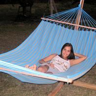 Outdoor Trendy Hammock with spreader bar and casual garden Look with turquoise and gray stripes